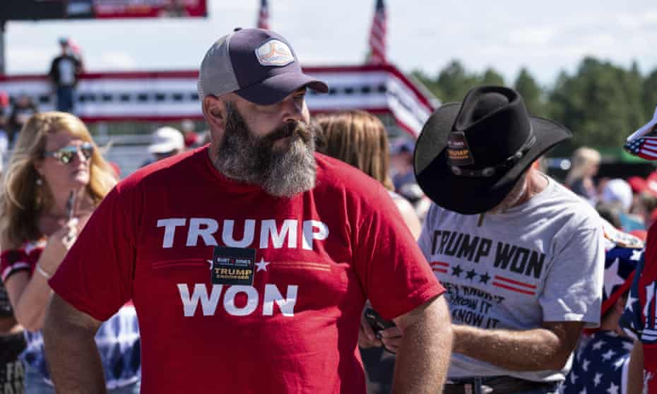 A supporter of the former president's fanciful claims of election fraud at a rally in Perry, Georgia, 25 September.