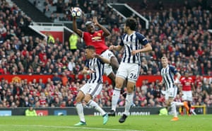 Manchester United's Paul Pogba handles the ball in the air as WEst Brom win 1-0 at Old Trafford, gifting the Premier League title to Manchester City.