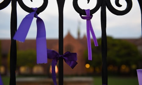 Purple ribbons are seen tied to the gates of Knox Grammar School as a tribute to victims of abuse.
