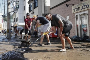 Canadian players help to clear up in Kamaishi following the cancellation of their match against Namibia because of typhoon Hagibis. The powerful storm unleashed torrents of rain and strong winds that left thousands of homes on Japan's main island flooded, damaged or without power.