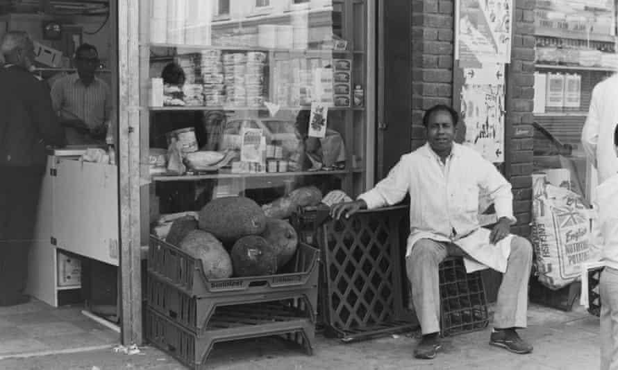 Having a break outside Ali Brothers grocery shop, Fashion Street, 1986.