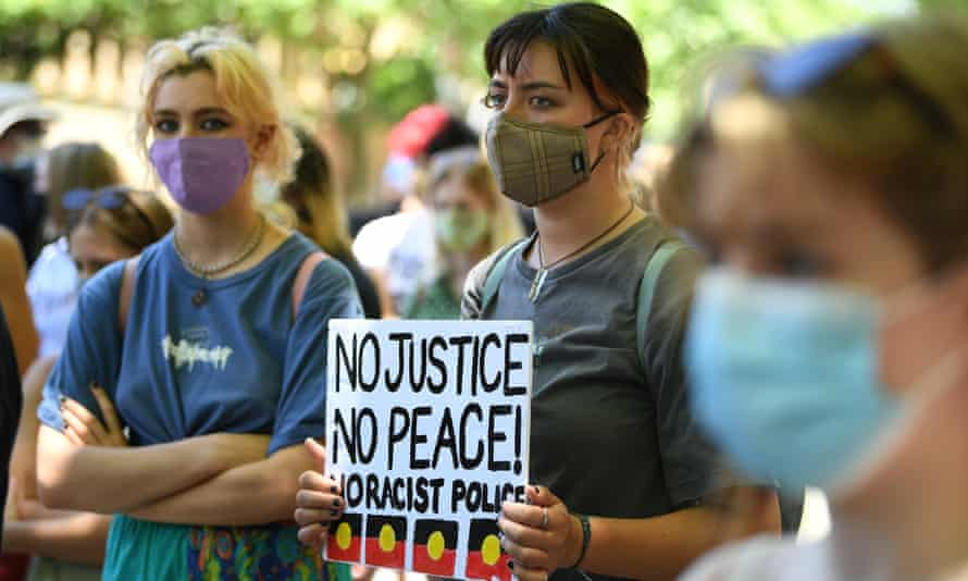 Protesters hold a placard at a Black Lives Matter rally in Sydney in 2020.