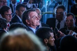 Brazilian president Jair Bolsonaro speaks to the press while leaving the Forum Of The Americas at the InterContinental Miami in Miami, Florida