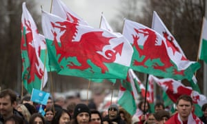 Crowd of people with Welsh flags