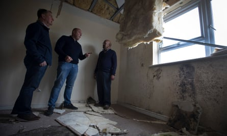 Andrew Broadhurst with leaseholders John Dickie and Fazle Syed in one of the flats