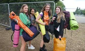 Festival goers arrive at Reading Festival on 26 August.
