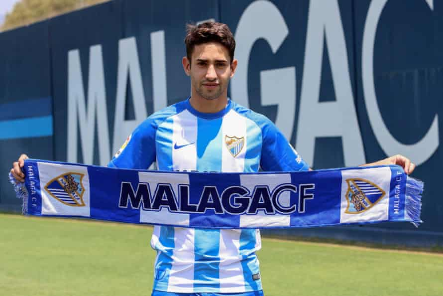 Argentinian midfielder Emanuel Cecchini poses for the media during his presentation as a new player of Malaga CF at La Rosaleda stadium