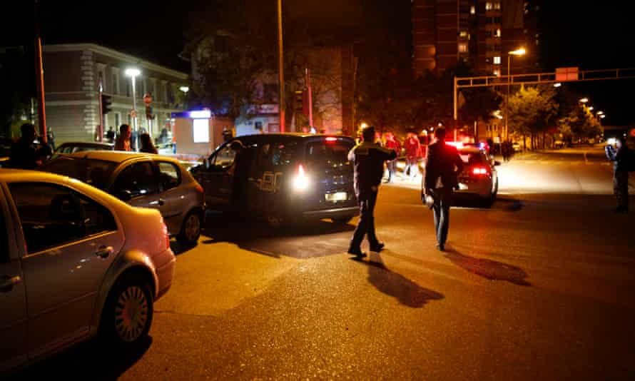 Officers secure an area near to a police station following a shooting in Zvornik.