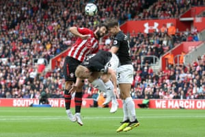 Southampton's Charlie Austin and Burnley's Tarkowski clash heads as Ben Mee avoids the pain during the goalless draw at St Mary's.