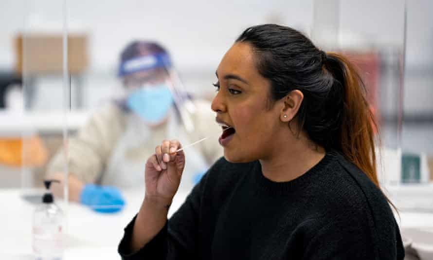A student inserts a swab into her mouth as part of a Covid-19 lateral flow test at Swansea University on 8 December.