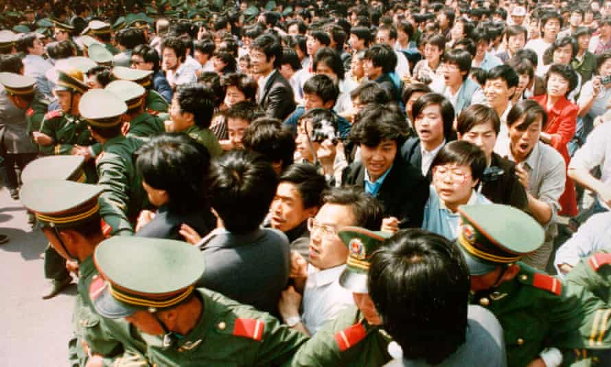 Students surge through a police cordon during a pro-democracy demonstration, June 1989.