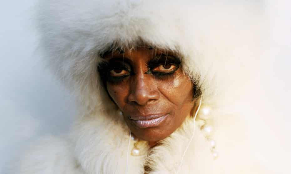 Woman in white fur coat and fur hood
