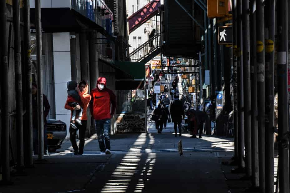People wearing protective masks walk next to Myrtle Ave. in the Bushwick neighborhood of Brooklyn on April 2, 2020 in New York City. Currently, over 92,000 people in New York state have tested positive for COVID-19.