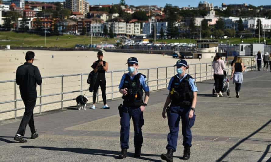 NSW police patrol the promenade at Bondi beach on 20 July during the Covid lockdown of greater Sydney