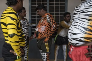 Local men paint their bodies to resemble tigers and leopards
