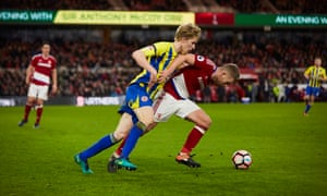 Middlesbrough's Adam Clayton cleverly holds off Accrington's loanee debutant Harvey Rodgers and wins a foul as the referee blows the final whistle.