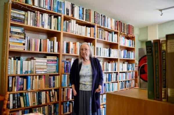 'I am so happy standing here in the middle of a pile of books.'