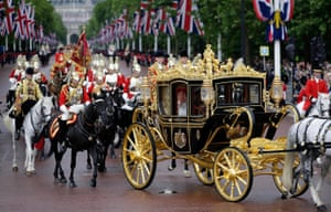 The Queen  returns to Buckingham Palace in the state coach following the State Opening of Parliament