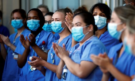 NHS workers at the Royal London hospital during the last day of the Clap for our Carers campaign in support of the NHS.