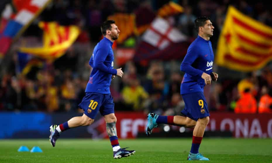 Lionel Messi and Luis Suárez head onto the pitch before the clásico against Real Madrid last December.