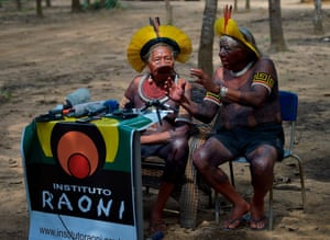 Sao Jose do Xingu, BrazilIndigenous leader Cacique Raoni of the Kayapo tribe (L) and an interpreter speak in Piaracu village