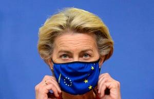 Brussels, Belgium European commission president, Ursula von der Leyen, adjusts her mask on the first day of a European Union summit.