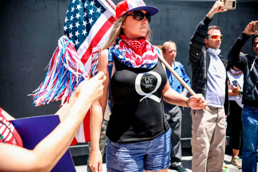 QAnon demonstrators protest during a rally to reopen California in San Diego on 1 May.