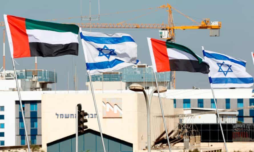 Israeli and United Arab Emirates flags line a road in the Israeli coastal city of Netanya