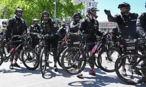 Sgt Jim Dyment (R) directs Seattle's bike squad