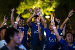 Leicester City fans in Bangkok celebrate.