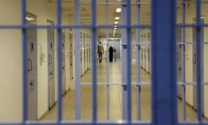 A view through bars of a long corridor in al-Ha'ir prison, Saudi Arabia