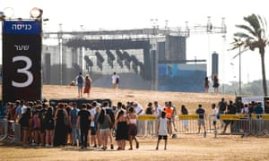 Fans wait to attend the outdoor concert by Radiohead.