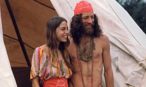 A couple attends the Woodstock music festival in 1969.