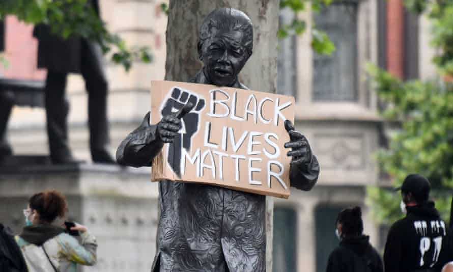 A statue of former South African president Nelson Mandela seen holding a Black Lives Matter placard