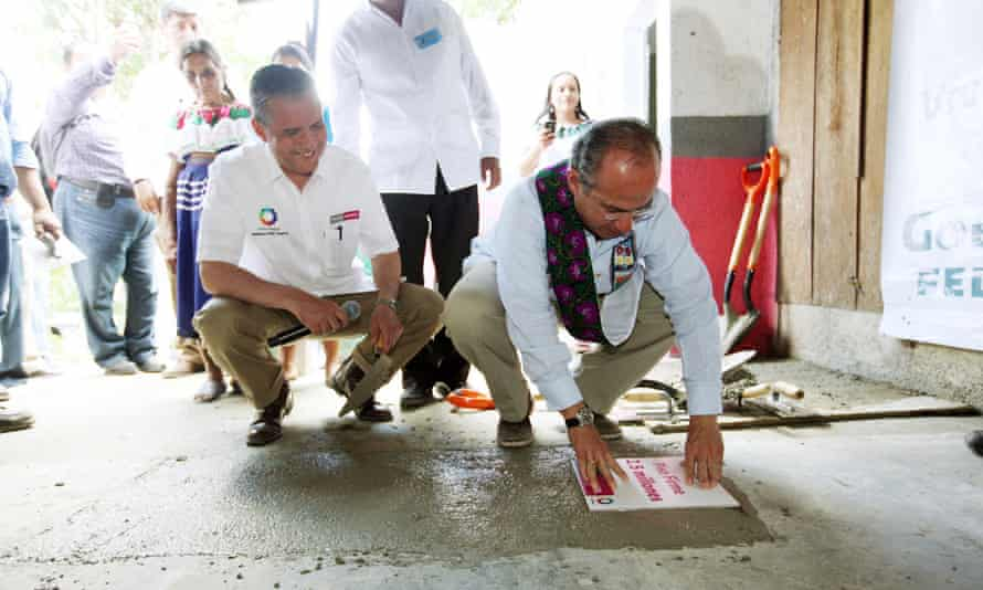 The Piso Firme programme in Mexico replacing a dirt floor with concrete.