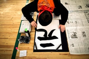 Tokyo, Japan. A calligrapher takes part in the annual new year calligraphy contest