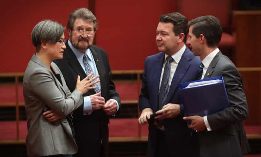 Labor senate leader Penny Wong, Derryn Hinch, Dean Smith and education minister Simon Birmingham in the Senate on Tuesday night during debate on amendments to the marriage equality bill