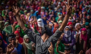 A Kashmiri Muslim shouts anti-Indian slogans as he attends the funeral of Jahangir Khanday