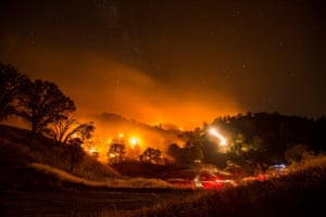 A long-exposure picture shows a backfire lit in an attempt to battle wildfires near Clearlake Oaks in California, US