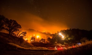 A long-exposure picture shows a backfire in an attempt to battle the so-called Rocky fire near Clearlake Oaks, California.