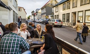 People have a drink at a bar in Reykjavik, Iceland, where equal pay is now being legally enforced.