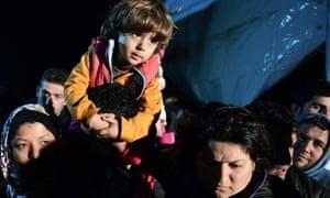 Refugees wait to cross into Macedonia from the greek village of Idomeni on Sunday 28 February.