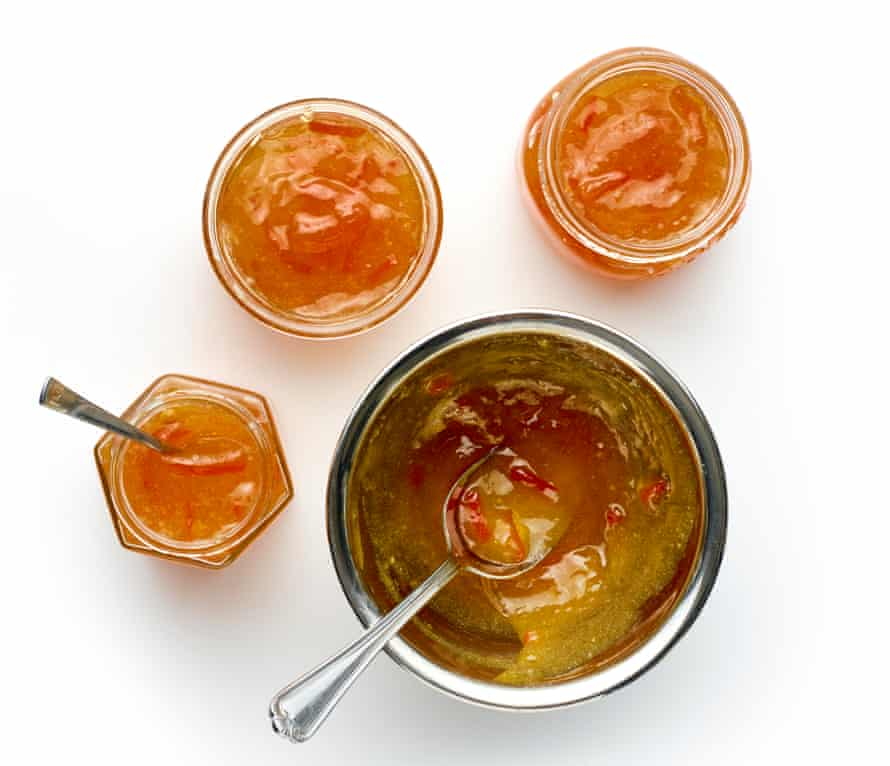 Cool for a moment, then spoon the marmalade into sterilised jars while it's still hot.