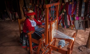 A woman working in Ccaccaccollo's revitalised weaving market, Peru.