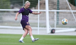 Toni Duggan practices her passing skills at an England World Cup training session in Deauville, France.