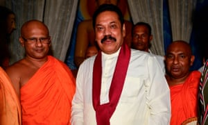 Mahinda Rajapaksa receives blessings from Buddhist monks after being named Sri Lanka's new prime minister.