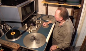 Ken Locke at work on the Steenbeck film editing machine.