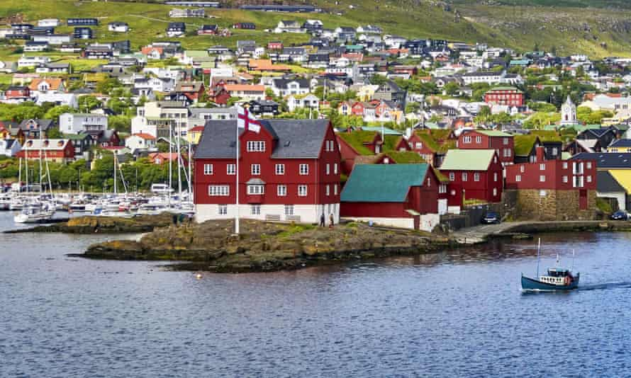 Port of Tórshavn.  Even in the capital, many of the houses have the traditional grass roofs of the islands.