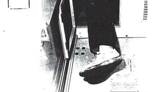 Frank Metzing's leg poking out of his hiding place after being discovered on a train from Prague to Nuremberg in May 1983.