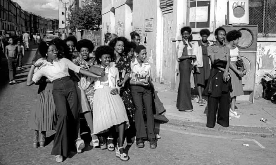 A crowd enjoying Notting Hill carnival in 1975.